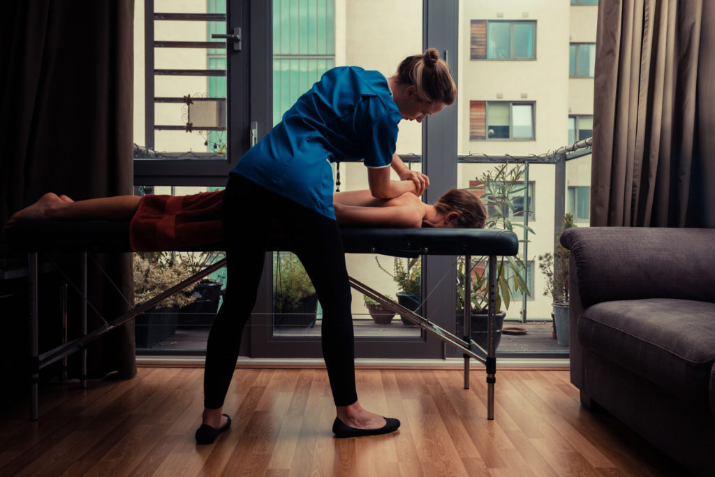 Massage Therapist Helps Patient Deal With Injury